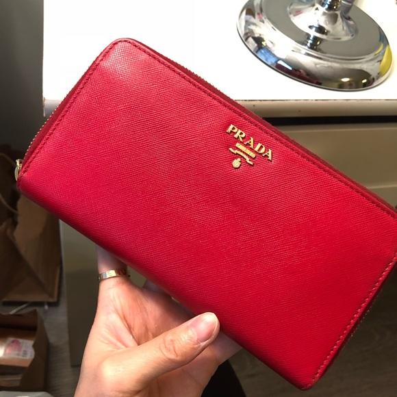 3ce15f90e80c Prada big wallet. Red. 💯 authentic. M_5a8b48e92ae12ff3d6b224d7